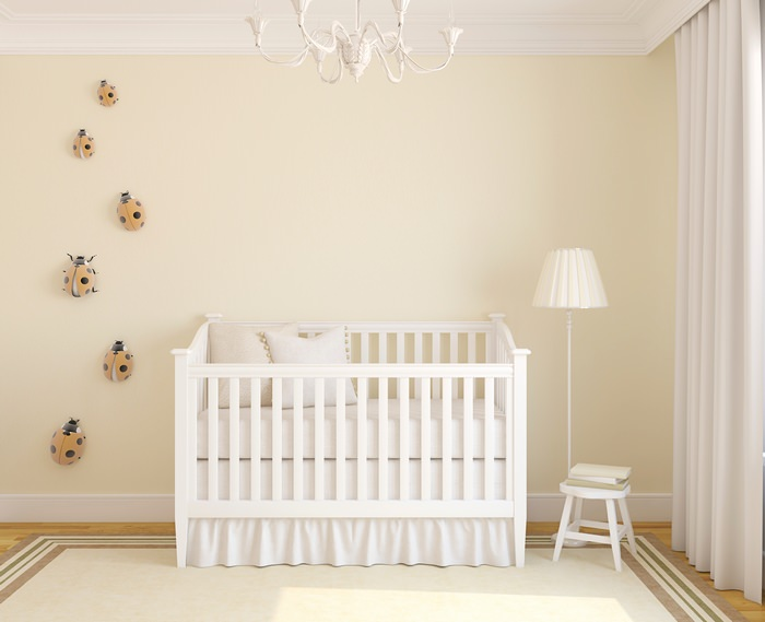 Nursery With Overhead And Floor Lighting